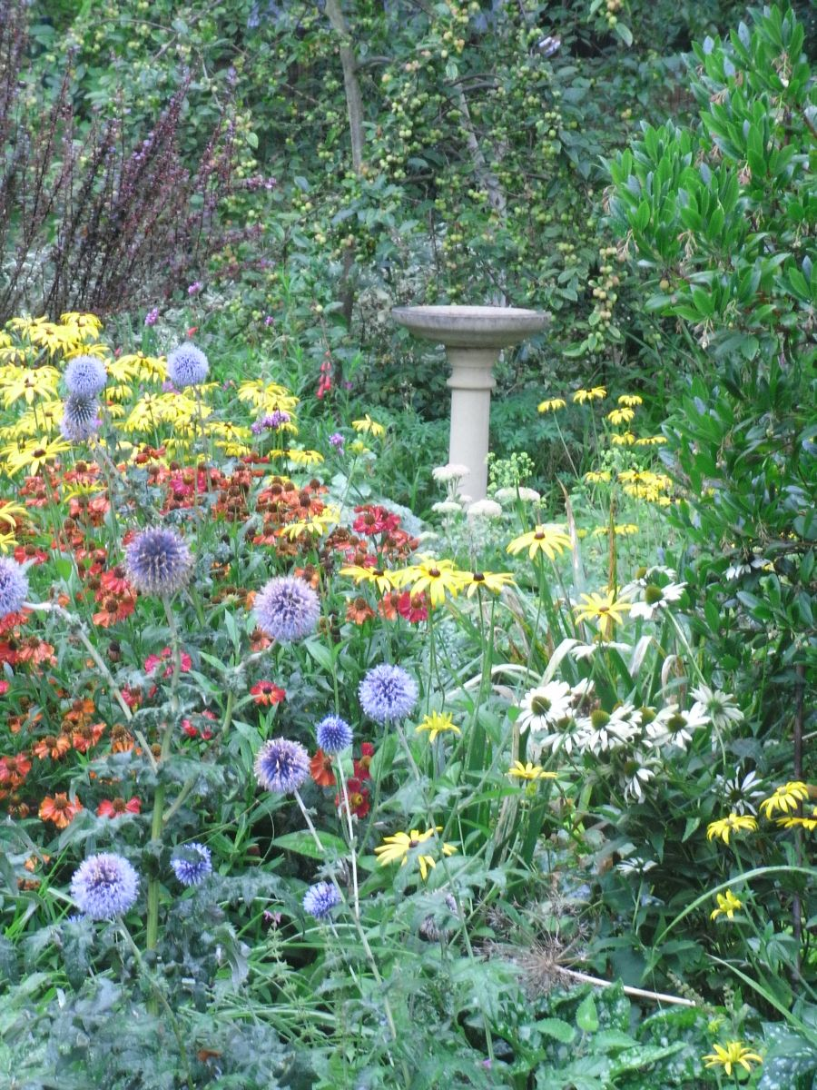bird tables add to a garden design